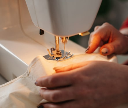 cloth being stitched on sewing machine